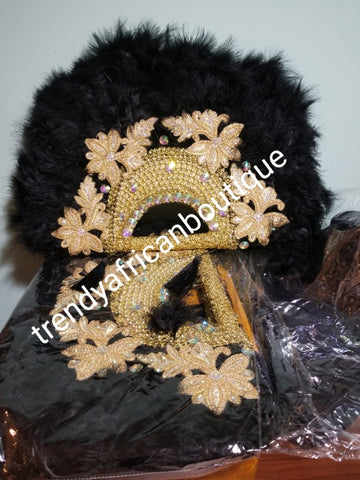 Large Black/gold color, Nigerian  made fluffy Feather hand fan. Hand made same front and back design with gold handle, 2 drop tassels and gold petals and beads  Bridal-accessories design with beads and flower petal. Model shown is gold color