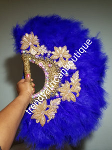 Large Royal blue/gold color, Nigerian  made fluffy Feather hand fan. Hand made same front and back design with gold handle, 2 drop tassels and gold petals and beads  Bridal-accessories design with beads and flower petal.