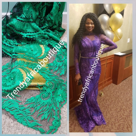 African net french lace fabric with all over stones. GREEN color. Sold 5yds. Model shown wearing purple