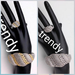 22k electroplated Bangle and Ring set. Dubai Hand set with CZ stones. Beautiful bangle. Available in 2 tone and all silver. Ring is one size fit