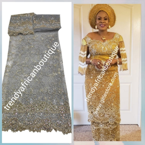 Ready to Ship: Bonus sale with matching aso-oke gele.  Ash/Gray Niger/Igbo Traditional Bridal outfit- quality  net George wrapper embellished with dazzling Crystals all over. 2 wrapper + 1.8yds net for blouse.  Model is wearing Gold color