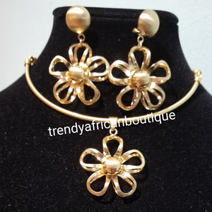 High quality 18k Gold plated 3pc pendant  set.  beautiful flower pendant with matching dangling  earrings. Sold with chain. Classic for casual wear.