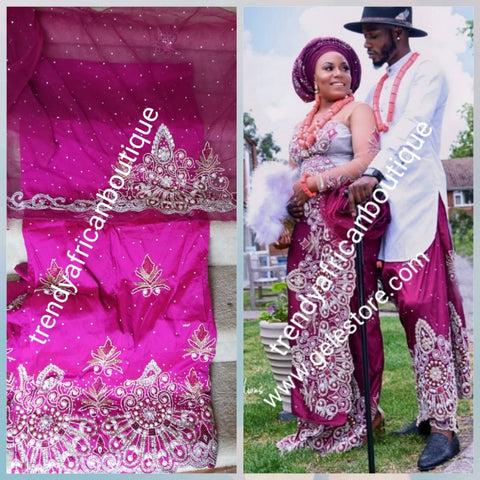 Ready to ship: luxurious Quality taffeta Silk George wrapper. Fuschia pink Nigerian Bridal beaded and crystal stoned George wrapper. Sold as  2 wrapper + 1.8yds Net for blouse. Niger/delta/Igbo traditional bridal outfit. Model shown wearing magenta color