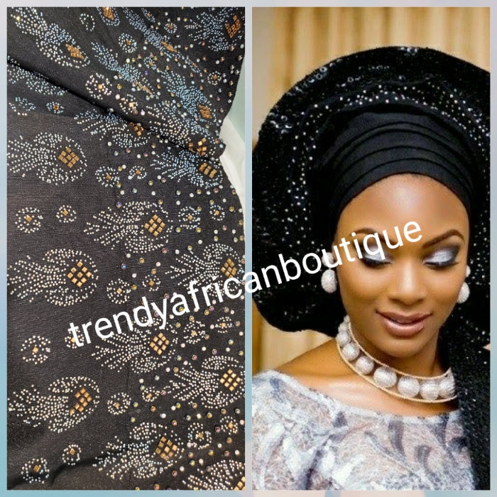 "Ebony Black Bedazzled aso-oke. Nigerian woven traditional Aso-oke for making  beautiful head wrap. Beaded and Swarovski stones work for perfect headwrap finish. Gele only. Extra wide gele for bigger head wrap. 72"" long × 26"" wide"