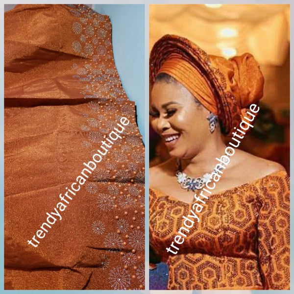 "Classic Burnt Orange Bedazzled aso-oke. Nigerian woven traditional Aso-oke for making beautiful head wrap. Beaded and Swarovski stones work for perfect headwrap finish. Gele only. Extra wide gele for bigger head wrap. 72"" long × 26"" wide"