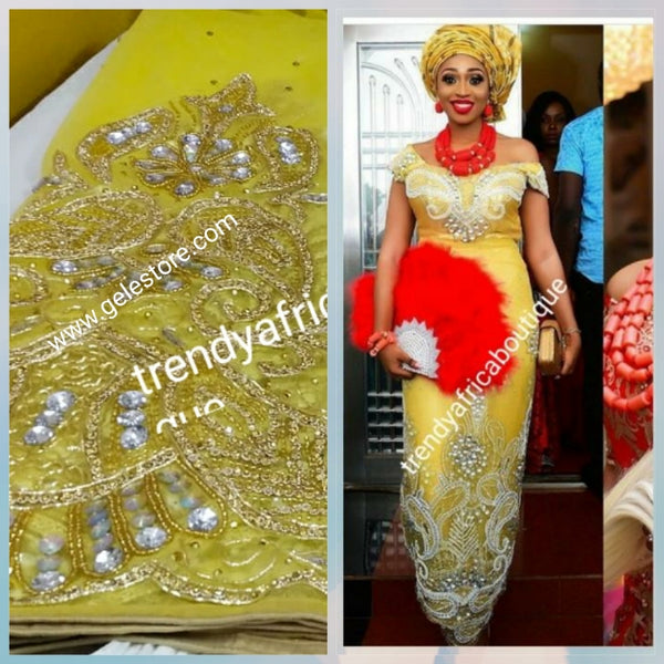 Ready to Ship: Gorgeous Igbo Traditional Bridal outfit- quality yellow net George wrapper and matching net for blouse. embellished with dazzling Crystal stones all over. 2 wrapper + 1.8yds net for blouse. Sweet yellow net Ideal for making Celebrant outfit