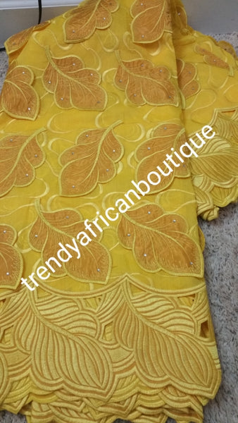 Special Sale: Original Swiss Embriodery Lace fabric embellished with organza leaf petals. classic Bold Border.  Great quality and texture for that special occasion. Sold per 5yds. Price is for 5yds