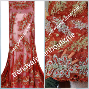 Produce-per-order: fully hand made embroidery net, embellished with beads and crystal stones for that Red carpet Nigerian Bridal ball gown. Sold in 6.5 full Yards. Igbo Traditonal wedding George Wrapper  6-8 weeks to produce color of your choice