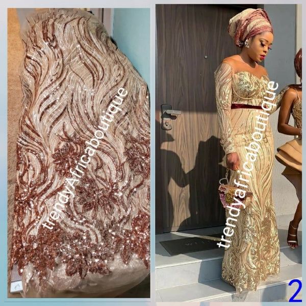 New arrival soft quality champagne/rose gold  french lace fabric with all over sequence. Great quality. Sold per 5yds.price is for 5yds. Aso-ebi price available. Contact us for details. Free shipping within U.S