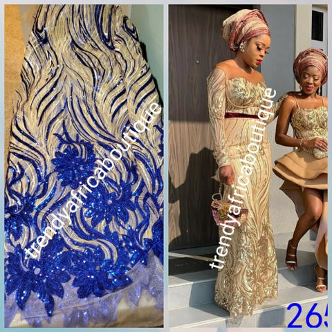 New arrival soft quality champagne/royalblue french lace fabric with all over sequence. Great quality. Sold per 5yds.price is for 5yds. Aso-ebi price available. Contact us for details. Free shipping within U.S
