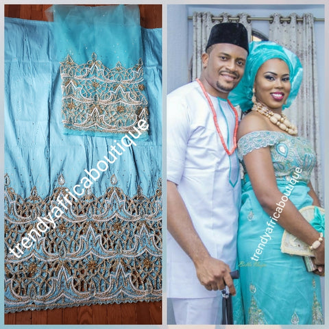 Special offer: Beautiful turquoise blue Nigerian traditional Igbo/delta women/men wrapper for big ceremoney. Original quality silk George wrapper for Traditional wedding oufit. Sold as wrapper and 1.8yds matching blouse
