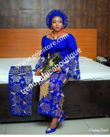 Custom-made Quality Swarovski stones, beaddazzled 4pc Aso-oke set + feather hand fan bonus. Made-to-order Nigerian Traditional wedding Bridal outfit for women. Allow 6-8 weeks for delivery. Can be made in any color of your choice