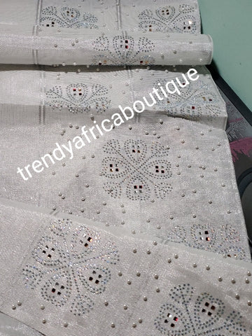 "Classic silver Beaddazzled aso-oke for making Nigerian latest party Gele.  Embellished with Clear and colored crystal stones. woven quality aso-ebi 82"" long x 20"" wide"