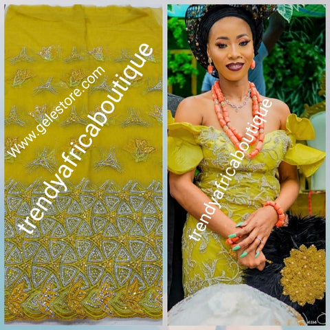 Sweet musterd yellow net George fabric embellished with dazzling Crystals. For that special occasion/igbo Traditional  Bridal outfit- net George wrapper/fabric 6.5yds. Use for making red carpet outfit. Model shown use similar fabric