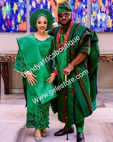Celebrant Aso-oke made for Nigerian Traditional ceremonies,  Make-to-order only. Custom-made in any color combination of your choice. Groom 4pcs set is all aso-oke, bride compliments laser cut aso-oke.Allow 6-8 weeks for order process. Green/orange/navy.