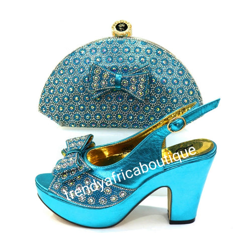 Europe size 38 Turquoise shoe and clutch set, dazzling crytal stones. Platform heal with matching stylish hand clutch. Comfortable and good balance shoe. True to size.