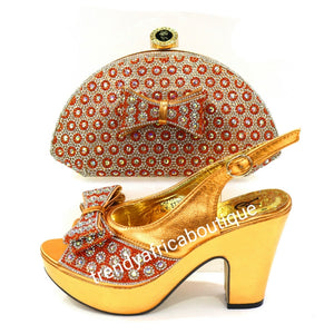 Europe size 39 Bronze/orange shoe and hand clutch set. Dazzling crystal stones. Platform heal with matching stylish hand clutch. Comfortable shoe and great balance. Light weight