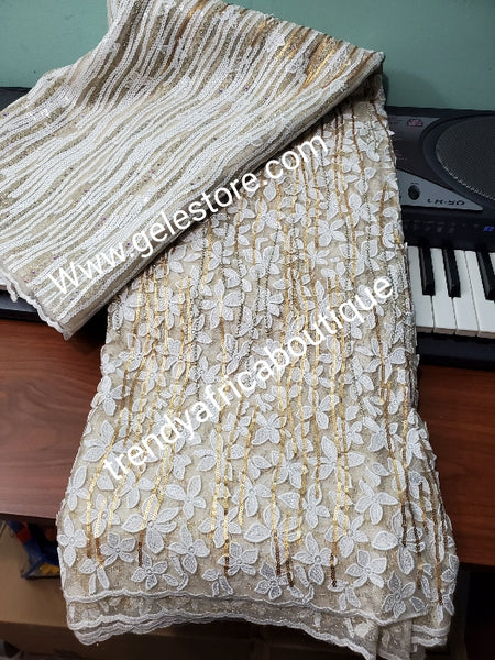 Exclusive unique Organza swiss  lace fabric. Embellished with sequence and stones. Big Quality design for wrapper, skirt /blouse. Cream/champagne gold lace fabric sold per 5yds. Nigerian wedding fabric