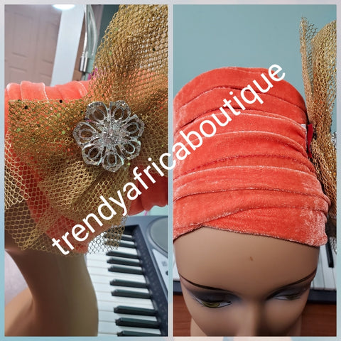 Orange velvet turban with gold color side design Women-turban. One size fit all turban. Beautiful flower design with a side brooch/beaded and stoned to add decor to your turban