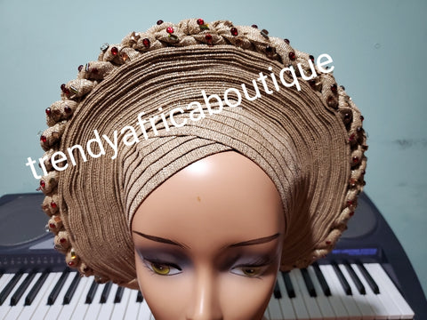 New arrival champagne gold auto-gele, classic design and  with wine color stones. made with Nigerian woven  aso-oke.  Party ready in less than 5 minutes. One size fit, easy adjustment at the back