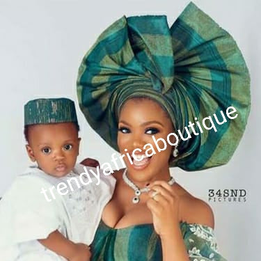 Nigeria aso-oke teal green/light gold as in model photo. Buba/iro 2 tone. + gele/ipele solid color teal green.Make-to-order. Custom-made design. Allow 6-8 weeks for order process.