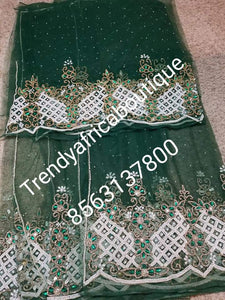 Clearance Net George: Nigerian VIP net Beaded and  Hand stoned George wrapper. .  5yes + 1.8yds matching net blouse. Sold as a set. Beautiful Green net George