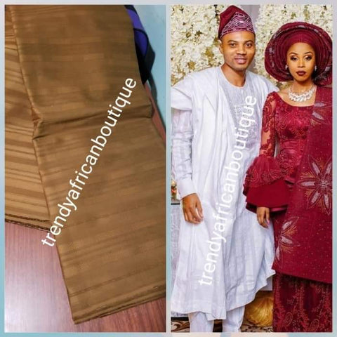 Sale sale: Top quality  Brown swiss voile lace fabric for Nigerian Men native outfit. Soft quality fabric. Can be use for agbada/3pc outfit for men. Sold per 5yds. Price is for 5yds
