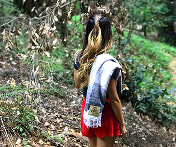 audris hiking through sanborn county park with the grey and white hermosa towel by helix towel co