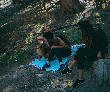 Tyler, Alexa, and Monet taking a break from hiking with Fudge on their Aqua Istanbul Helix Towel