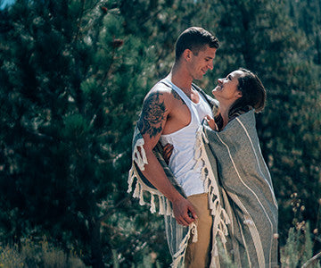 Alexa and Tyler sharing a beautiful romantic moment on their hike with a Black Buenos Aires Helix Towel