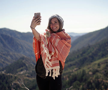 Alexa taking a selfie with the Red and White Buenos Aires Helix Towel