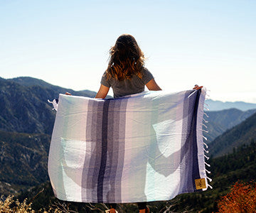 Alexa observing the open wild space with her Blue and White Hermosa Helix Towel