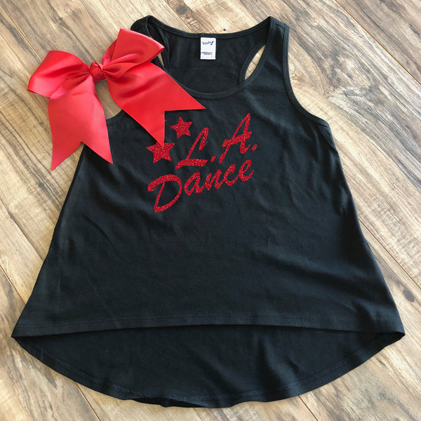 LA Dance Youth Racerback Tank. Absolutely adorable! This season's favorite top for girls adds an amazing touch of fun. With a flowy shape and a high low hem, this scoop neck tank makes a statement layered or all on its own. Made of sheer jersey for an ultra-soft touch.