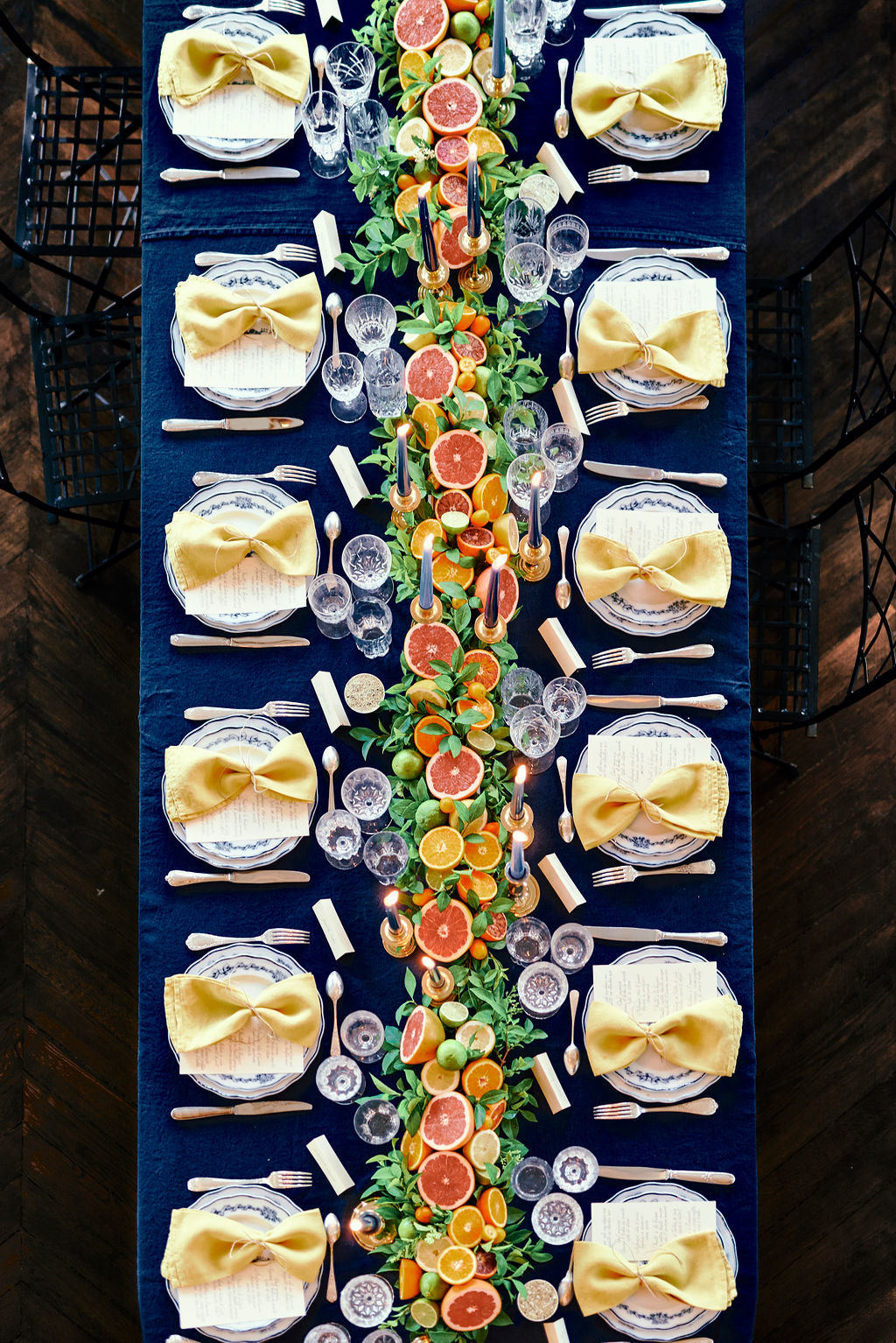Citrus runner | citrus centerpiece | floral citrus centerpiece | blue and yellow linens by Madame de la Maison