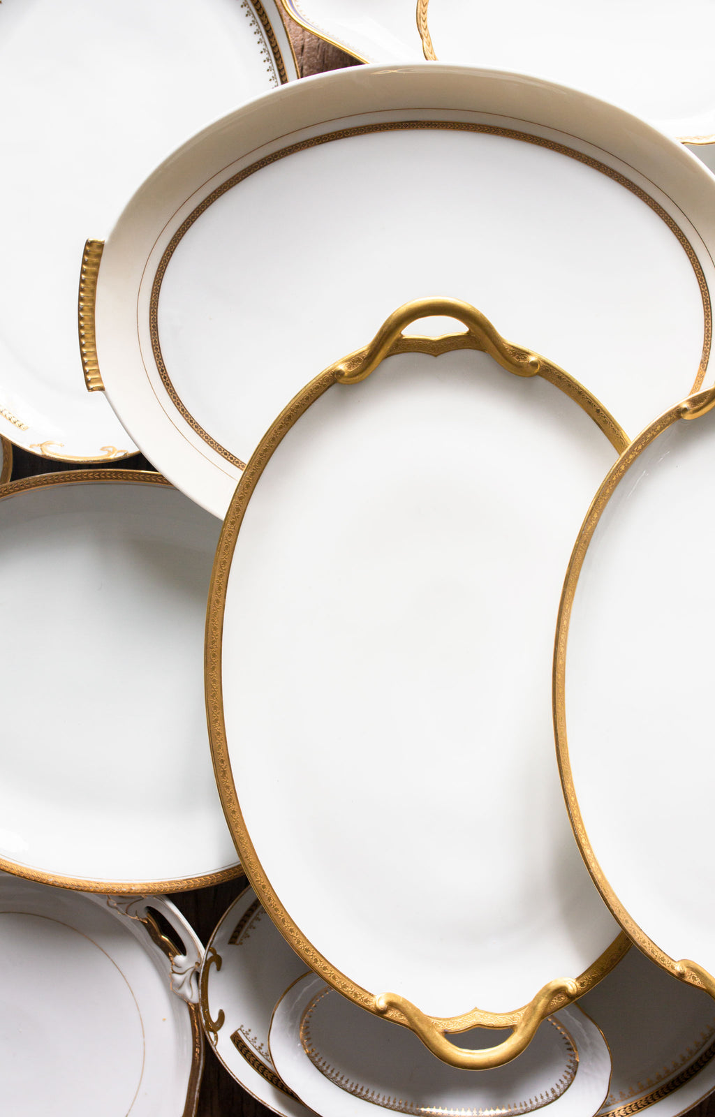 Antique gold and white rental serving dishes from Madame de la Maison