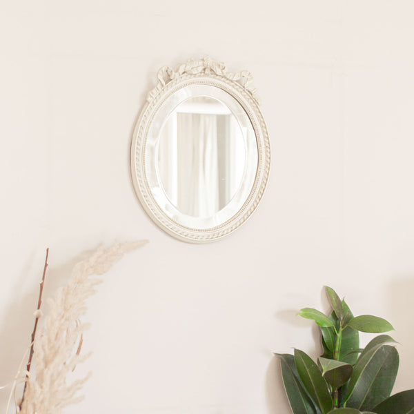 Antique white ribbon oval mirror sold on www.madamedelamaison.com