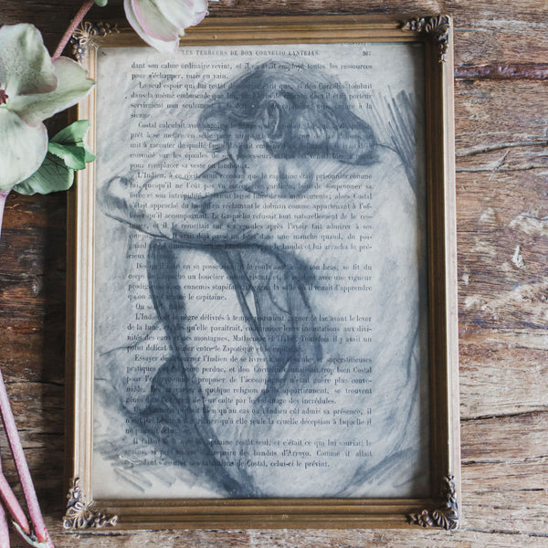 Framed Nude Drawing on Text