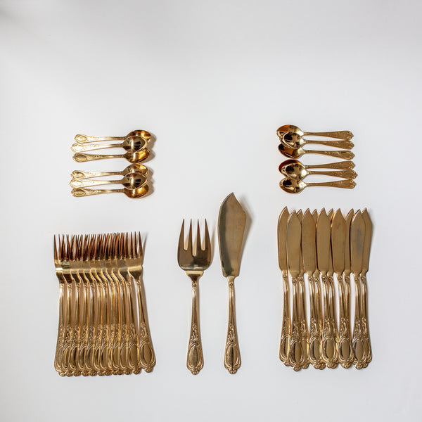 Antique set of gold silverware for serving fish from Madame de la Maison