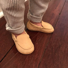 Toddler wearing Baby Hughie loafer standing on wood floor