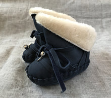 Navy blue Baby Myles Moccasin Booties on sack cloth