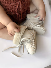 Baby in brown outfit wearing Baby Myles Moccasin Booties