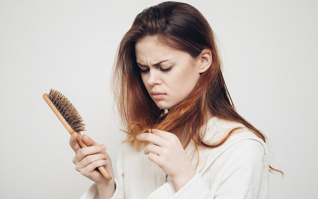 Hair Fall Due To Stress: The Connection, Types, Symptoms & Solutions