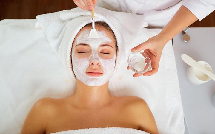 Women applying facials on her face