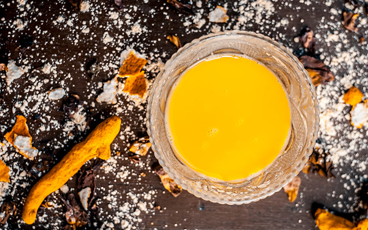 Honey,chickpea flour and paste,turmeric powder and rose petals on a wooden surface