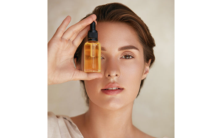 Model Using Natural Cosmetic Product For Hydrated, Glowing And Healthy Facial Derma