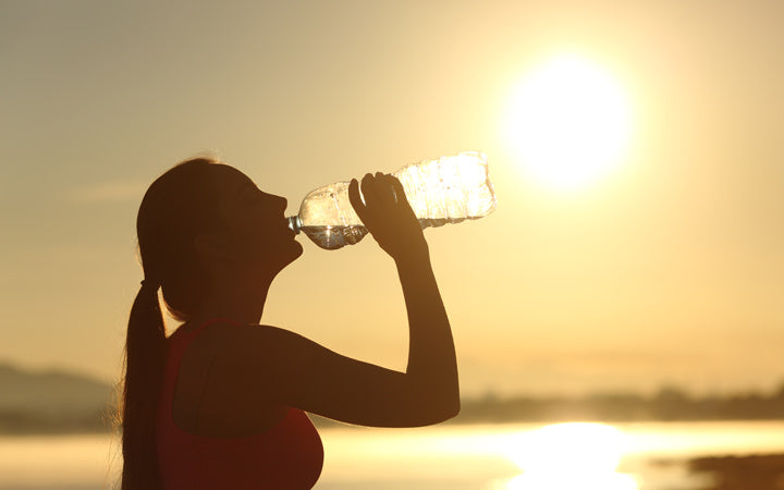 Woman drinking water to get hydrated