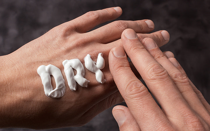 The word dry is written in cream on hands