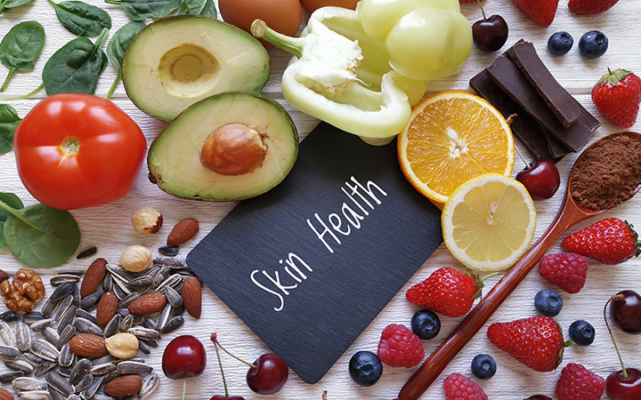 Various natural food products high in vitamins and minerals for skin health