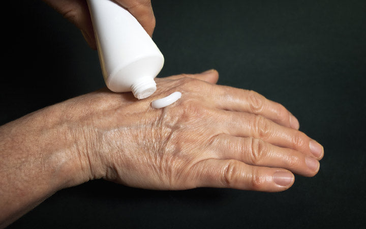 applying cream for hands