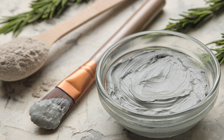 cosmetic clay facial mask on light